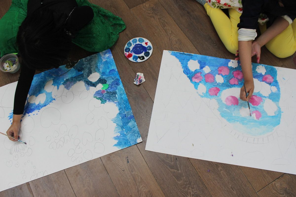 History of art class at 3 House Club, London - children created paintings on very large sheets of paper, inspired by Monet's 'Water Lillies'