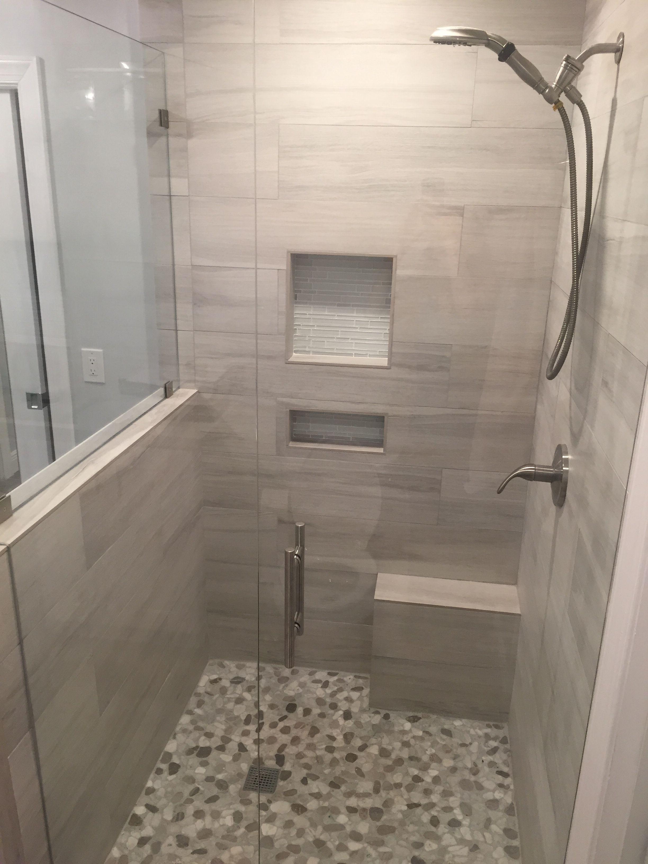 grey woodlike bathroom shower area added cutouts into