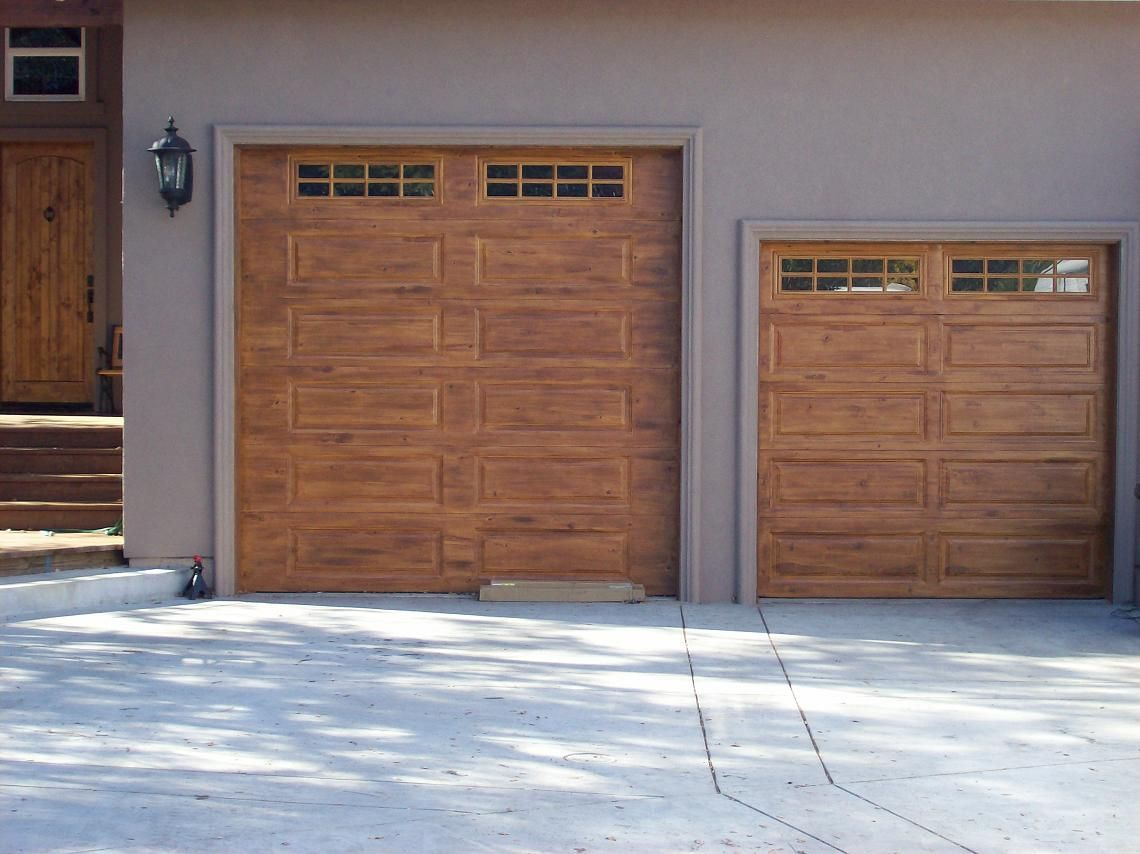 Garage doors painting your garage doors to look like for Wood looking garage doors