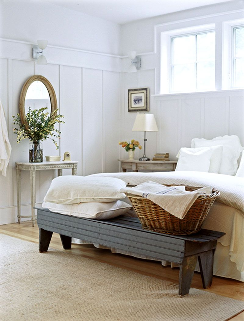 love the bench, pillows and basket at the end of the bed.