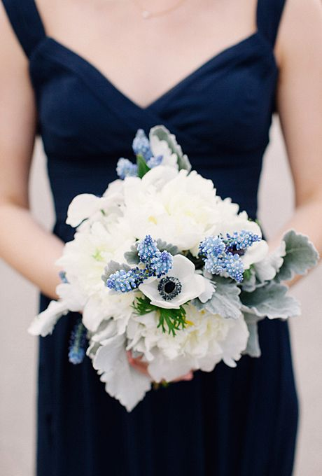 Brides.com: A Traditional Wedding in Chicago, Illinois. Bridesmaids carried mostly-white peony and anemone bouquets accented with a touch of lavender.
