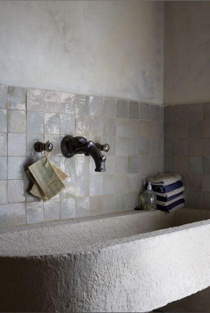 Bathroom glory with concrete walls, stone bathtub and tiles