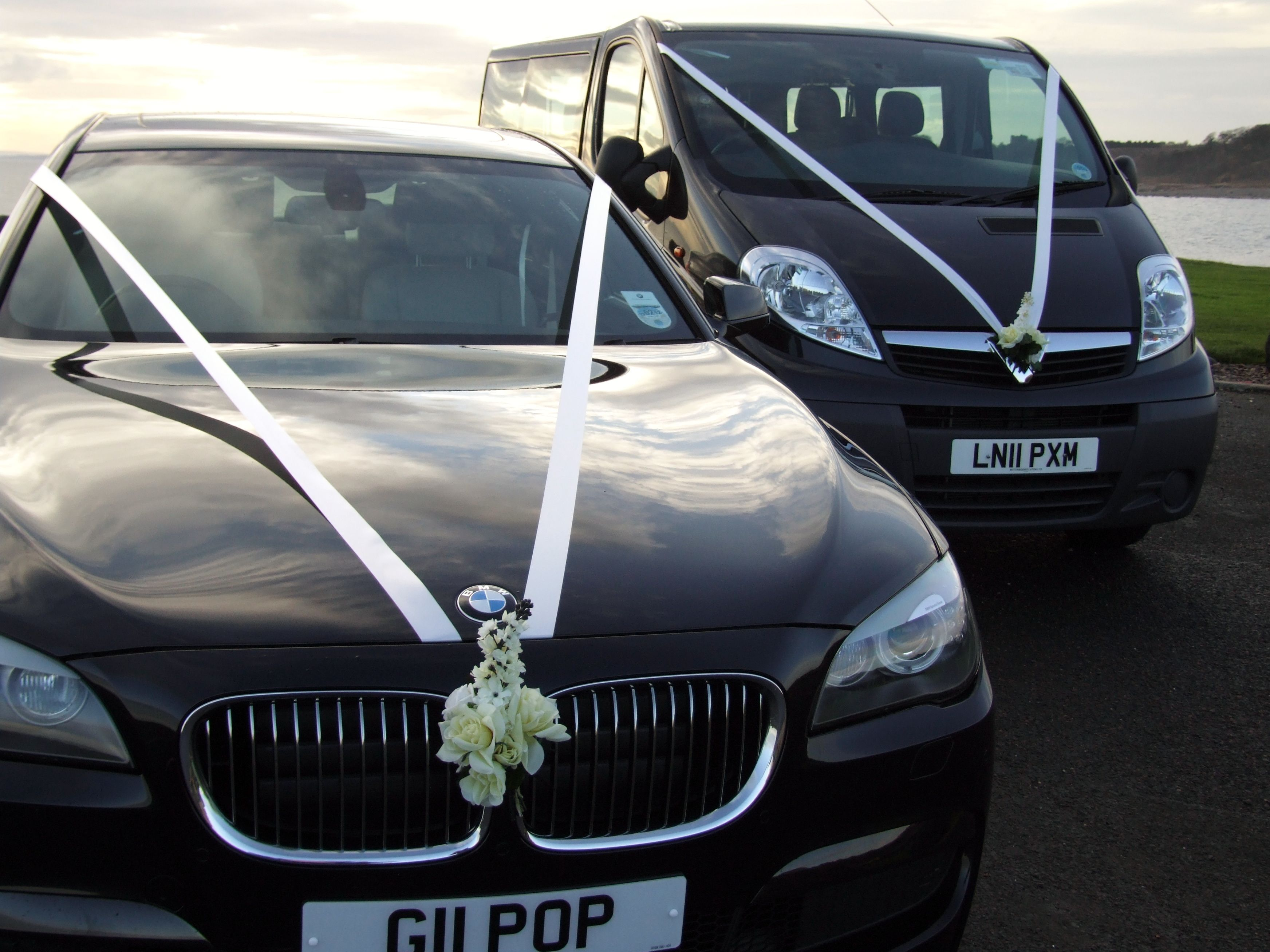 Our Bmw 7 Series Car And 8 Seater Minibus With Ribbons Flowers For Wedding Hire