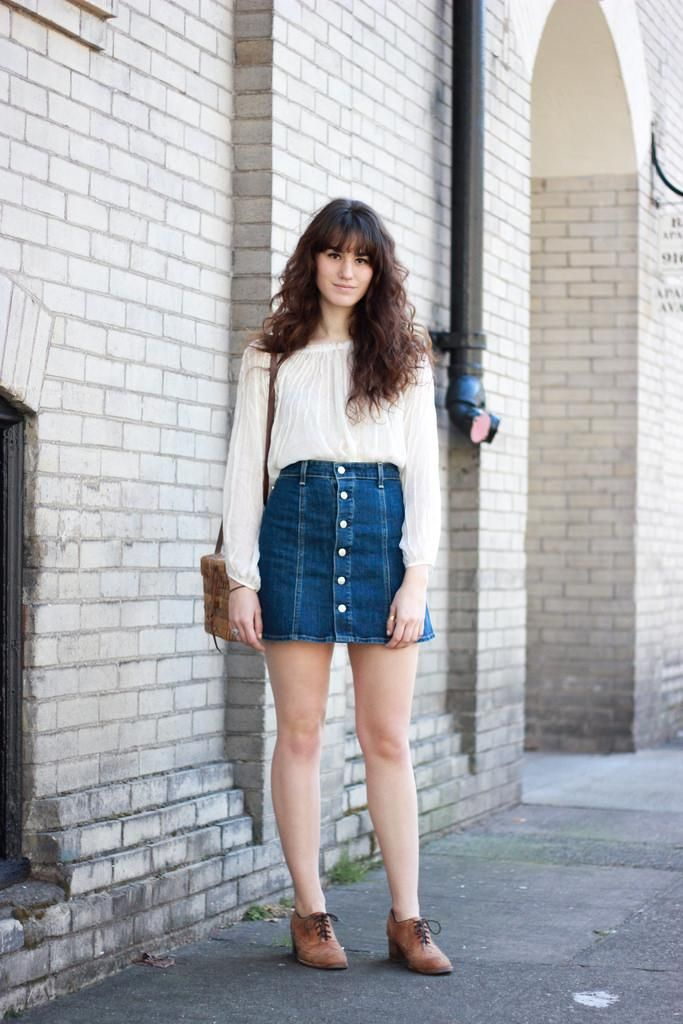 a75c3126da3 20 Modern Ways to Style a Denim Skirt for Spring - channeling the '70s in a  button down denim mini skirt + long sleeve white blouse
