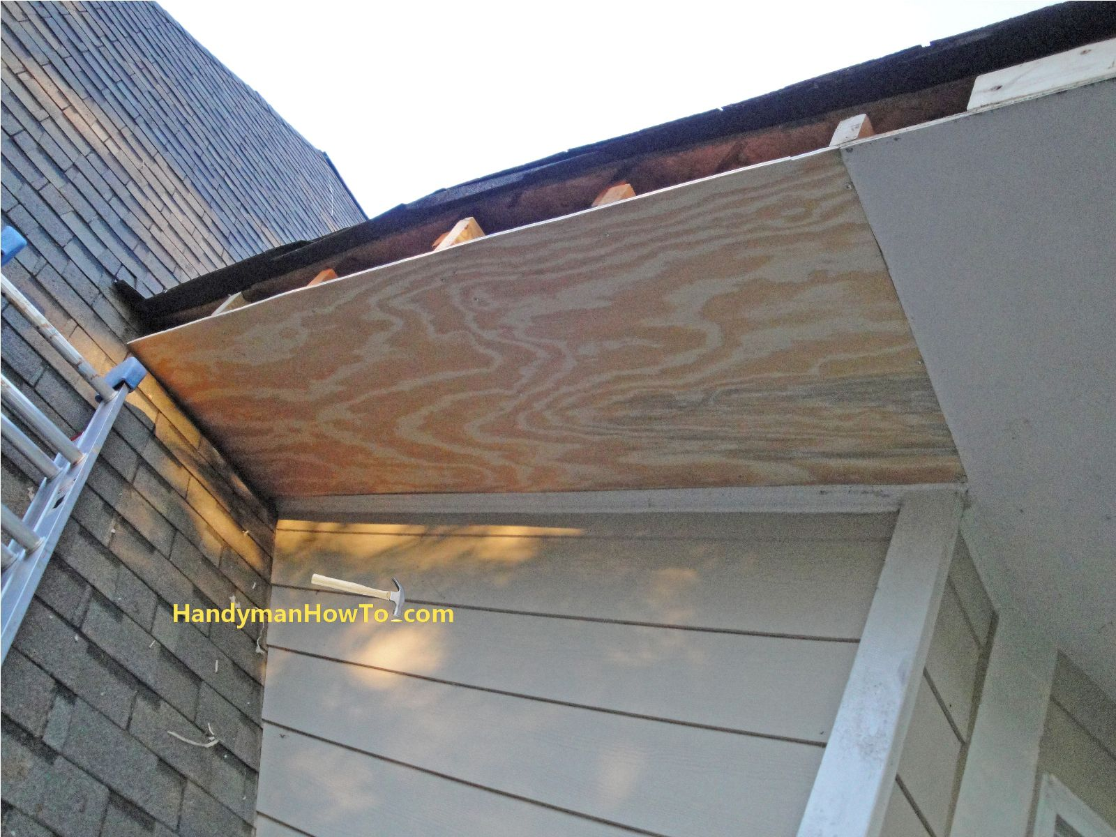 Replace Rotted Soffit: New Section Of Plywood Soffit Installed