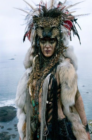 Shaman Makeup and costuming. Note the use of feathers, furs and the animal headpiece.