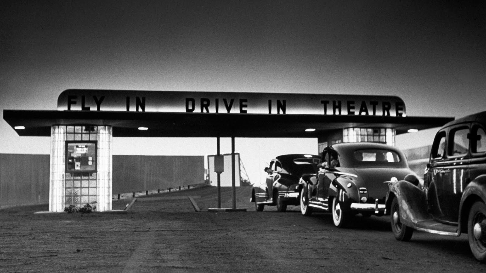 Customers arriving at the flyin drivein theater in wall