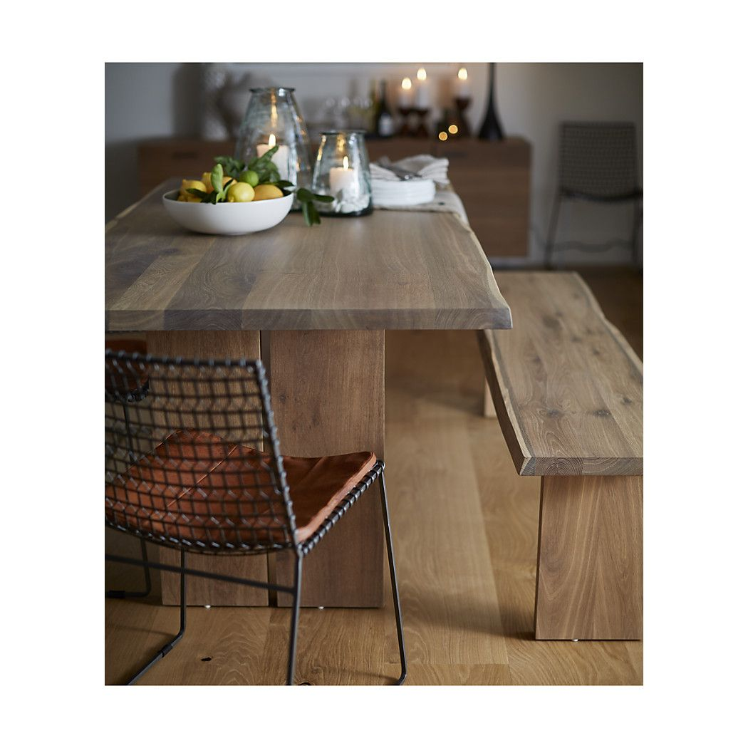 "Shop Dakota Dining Tables.   The subtle grey tones are achieved by ""fuming,"" a technique which reacts with the wood's natural tannins to alter the color without stain."