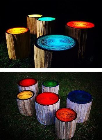 Glow in the dark painted tree stump stools. These would look cool on the beach, or around a camp fire.