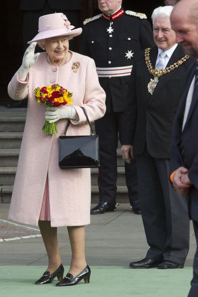 Queen Elizabeth II outside Manchester Town Hall on March 23, 2012 in Greater Manchester, north-west England.  The Queen and her husband, Prince Philip, the Duke of Edinburgh visited Manchester