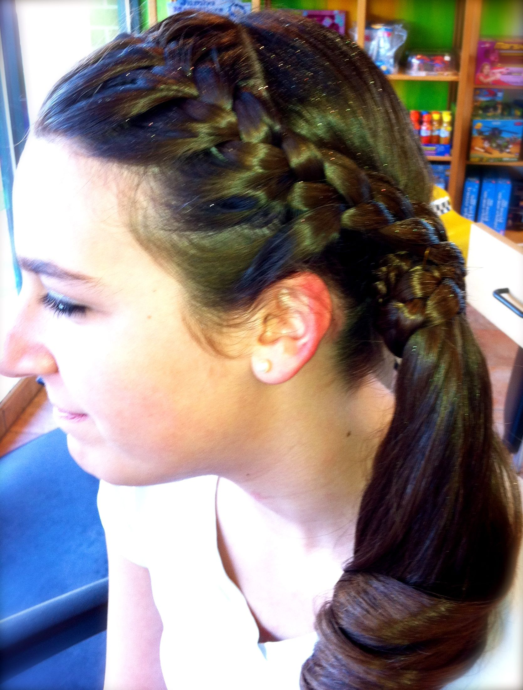 Braided & Wrapped around a Curled Side Pony Tail with lite glitter