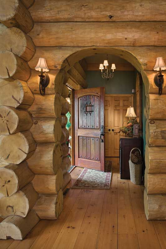 The Entry Showcases Large Handcrafted Logs Wide Plank Flooring And A Custom Made Rustic Door Log Homes Log Cabin Homes Cabin Homes