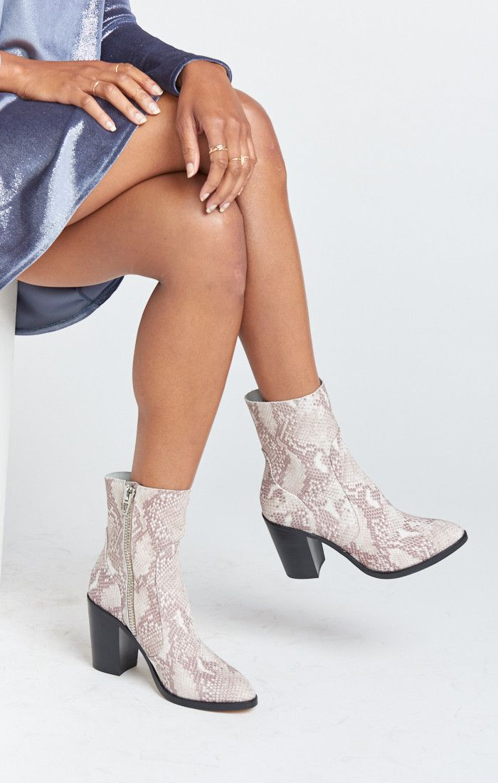 Complement your mu-fit by zipping up into these snake skin booties that are  both