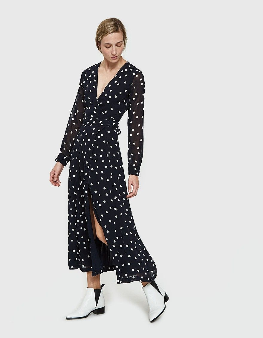 bc81661c1aa1 Wrap dress from Ganni in Total Eclipse. Sheer fabric with allover polka  dots. Deep V-necklne. Long sleeves with single-button cuffs. Wrap-front  closure with ...