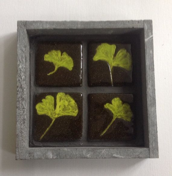 4 ceramic tiles in a grey wooden frame leaves door HollandCeramics