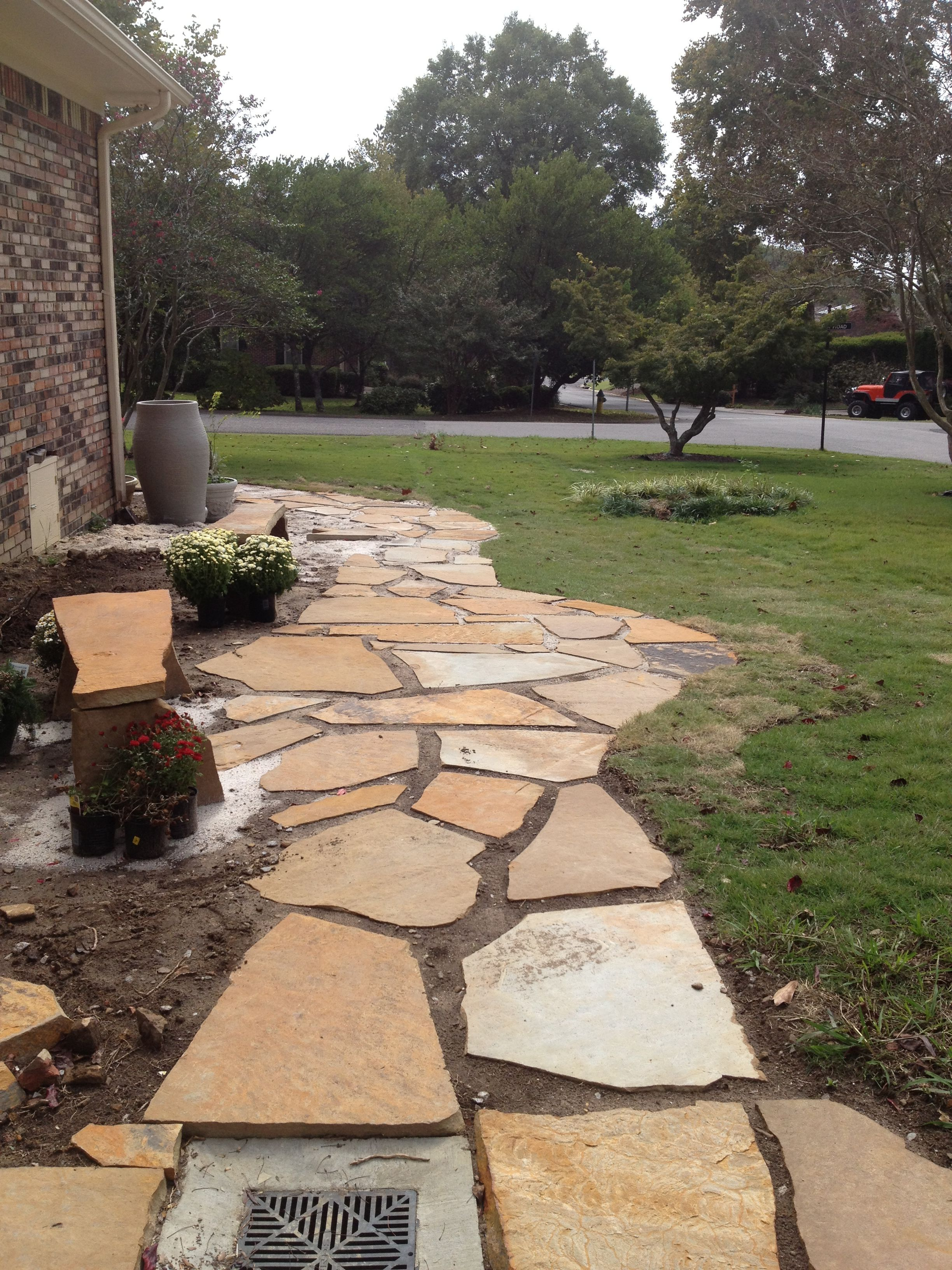 Alabama brown flagstone walkway with stone benches.