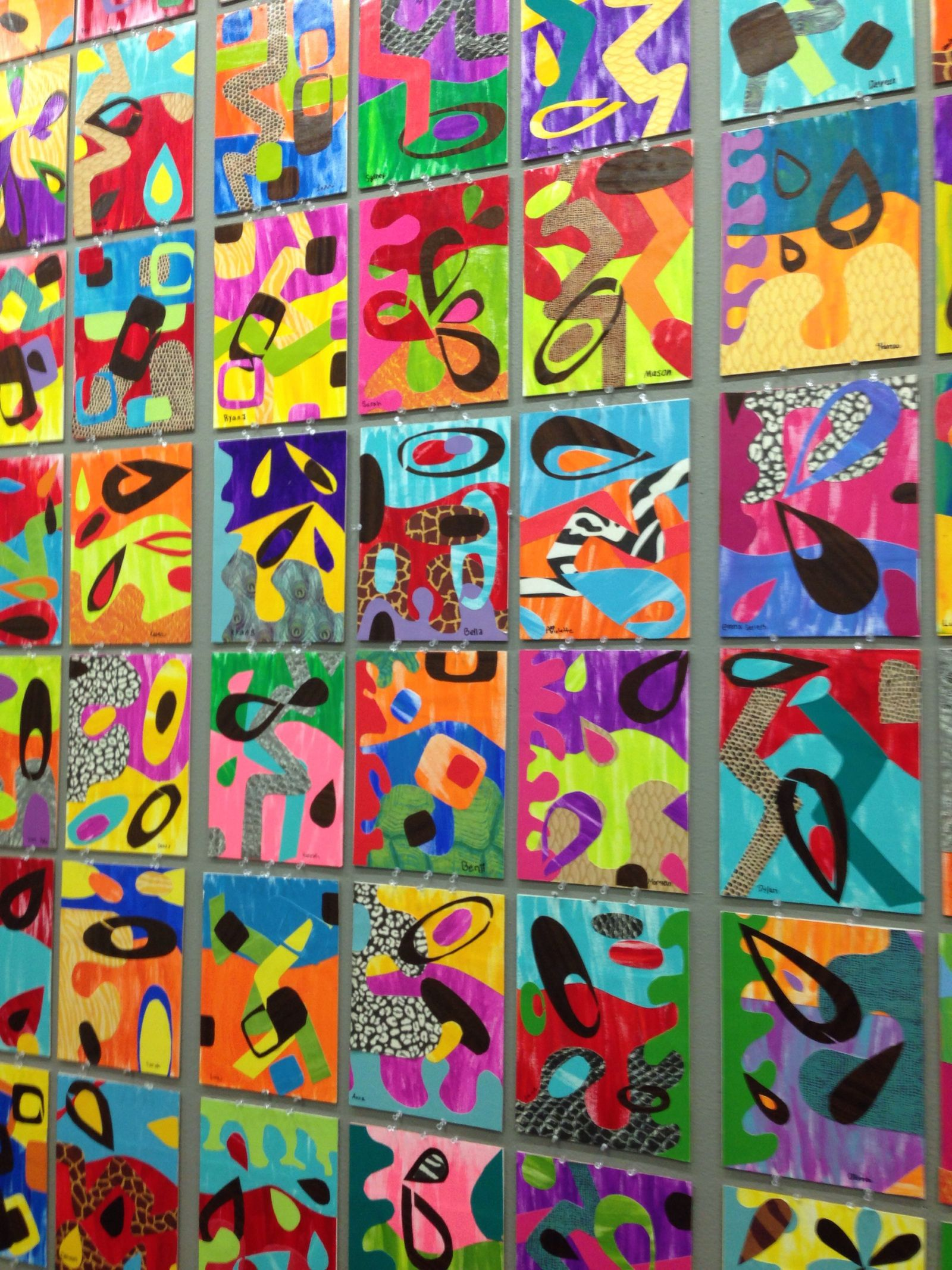 His flowing geometric artworks were a lesson in balance of shape and color students painted their own papers and used wood paper along with