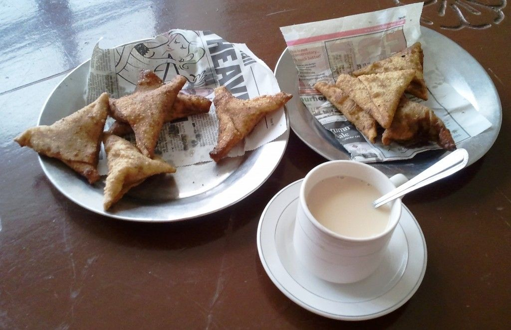 Tea time in Hargeisa, Africa. Sweet Somali tea with cardamom.  Sambuusas filled with lentils and cabbage.