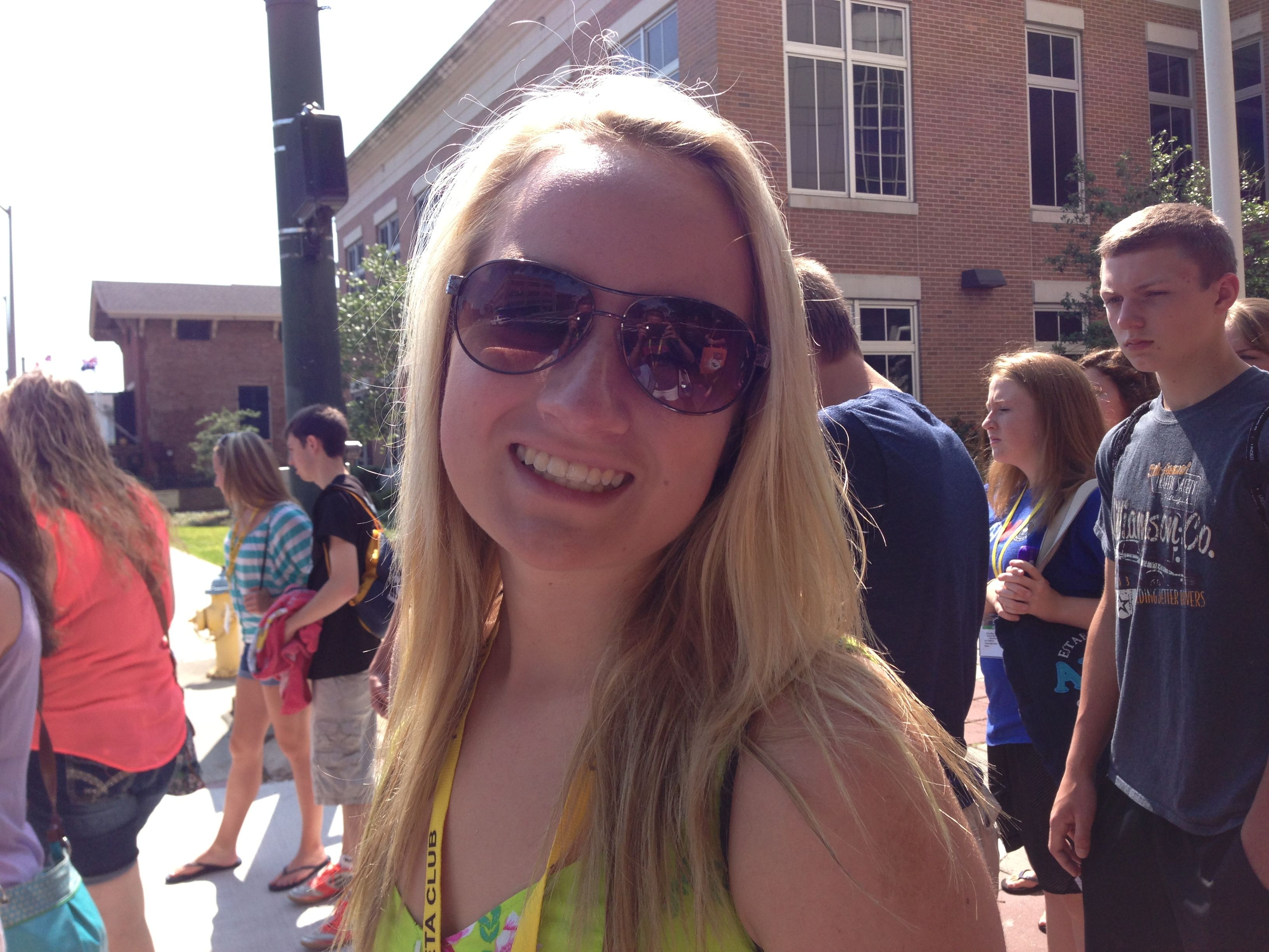 Heather Holmes of Lawrenceville, IL walks to the convention center during the National beta Convention in Mobile, AL on June 22, 2013.