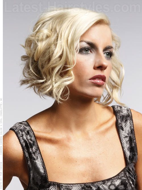 Medium Curly A Line Bob Hairstyle Sideview Blow Dry Hair Using Round Brush For
