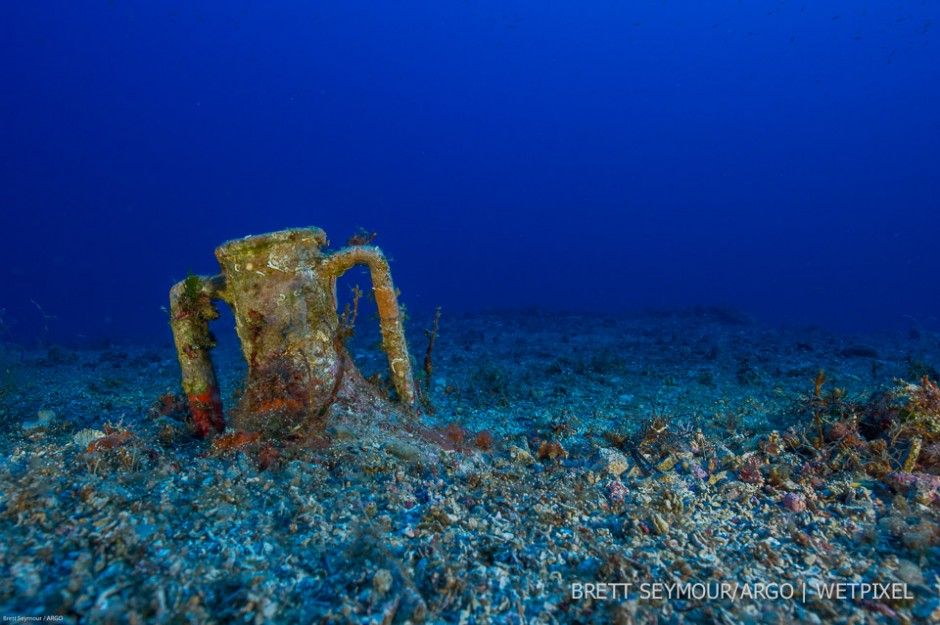 2,200 years under the sea- an intact amphora from the Antikythera shipwreck rest in the sediment.