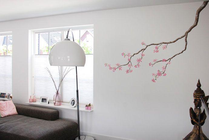 Bloesem muurschildering in een woonkamer gemaakt door Birgit Charles ...