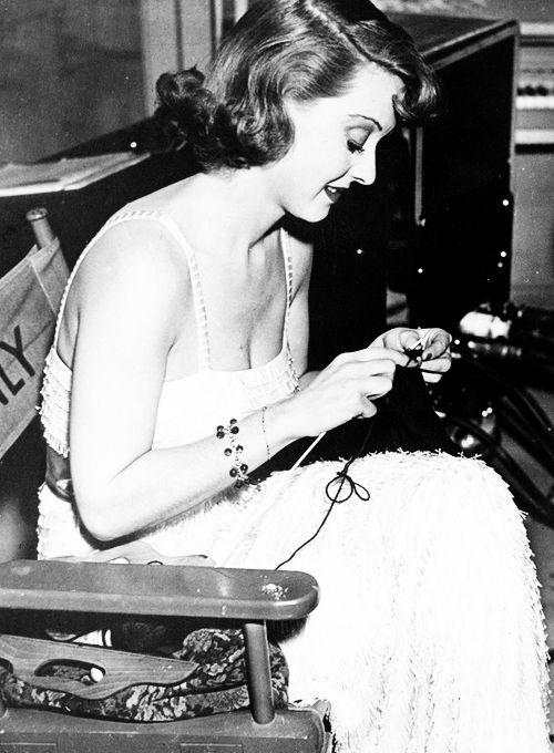 Bette Davis knitting on set, 1937.