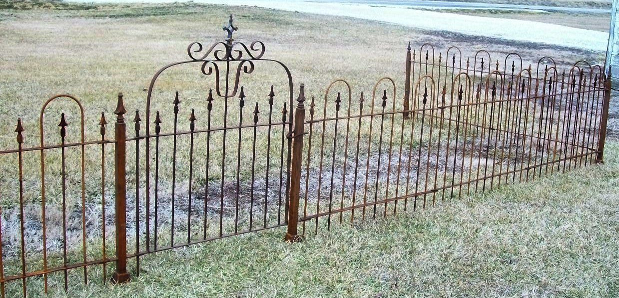 A Short Wrought Iron Fence Can Serve Multiple Purposes When Placed