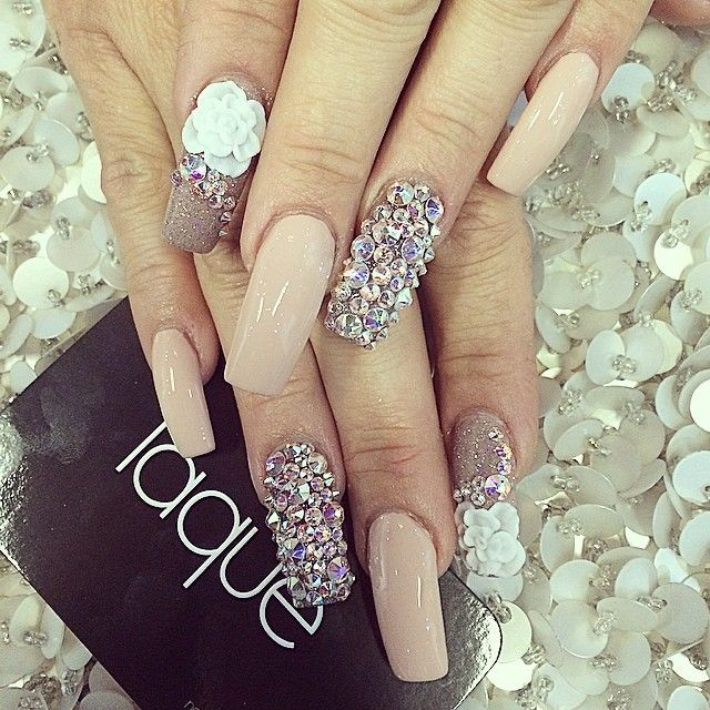 Nude nails with rhinestones covering ring finger and white flower nude nails with rhinestones covering ring finger and white flower over rhinestones on pointer prinsesfo Gallery
