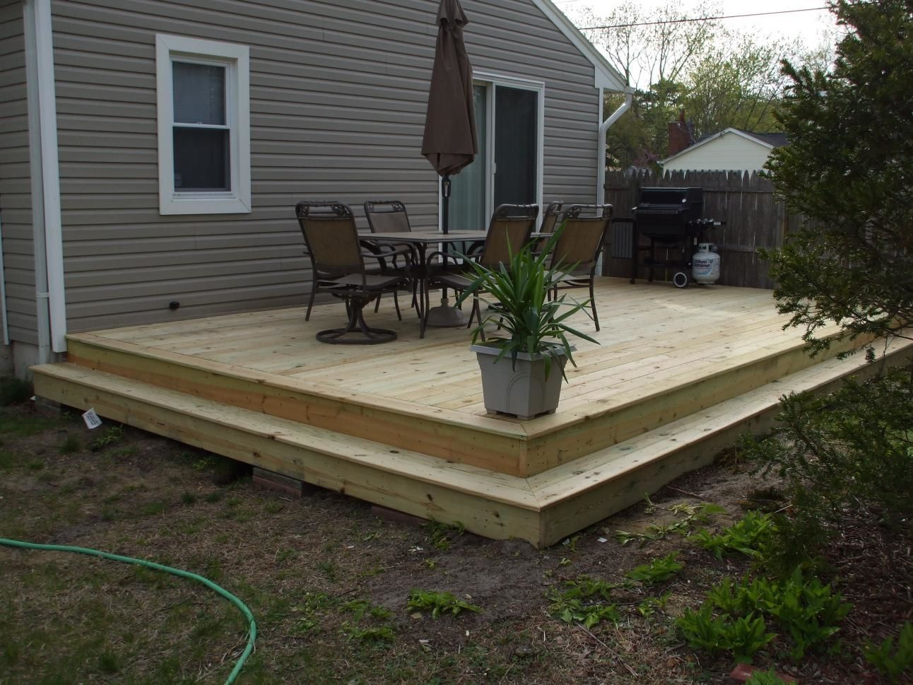 How to build ground level wood deck without posts for Backyard decks