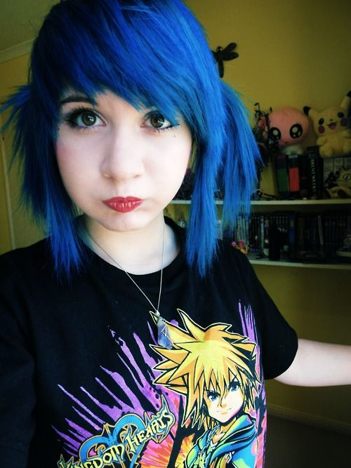 kingdom hearts shirt and bright blue hair in pigtails with side swept choppy bangs