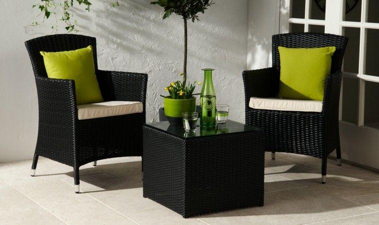 Sillones negros con cojines verdes muebles de ratan y - Cojines sillas exterior ...