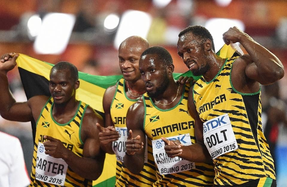 The Jamaican relay team (L-R) Nesta Carter, Asafa Powell, Nickel Ashmeade and Usain Bolt celebrate after winning the final of the men's 4x100 metres relay athletics event at the 2015 IAAF World Championships in Beijing on August 29, 2015 (AFP Photo/Johannes Eisele)