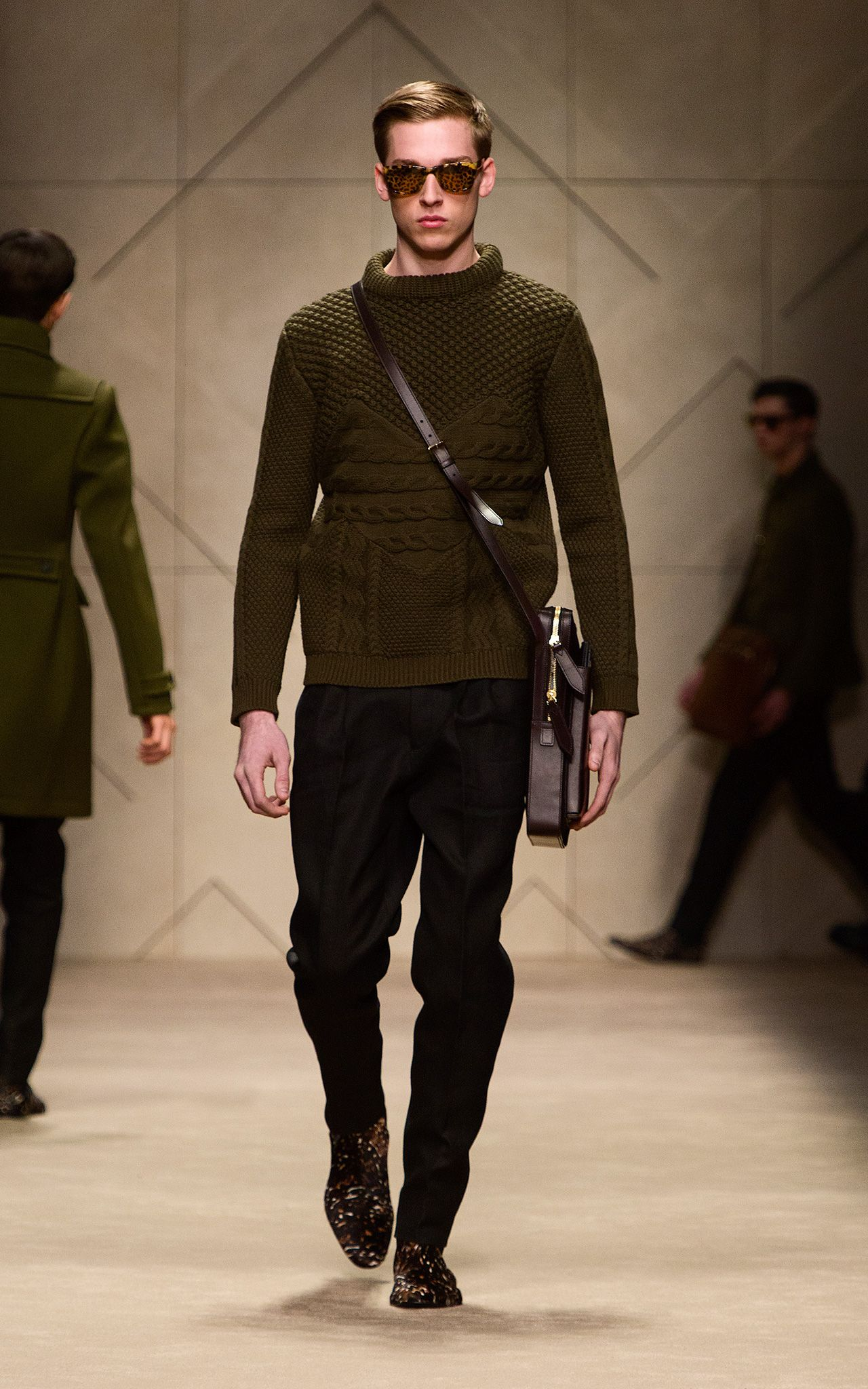 Olive Aran knit sweater and leather satchel on the runway of the Burberry A W13  Menswear show 9e781a8e9f0c5