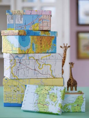 map-covered boxes (hmm... could recycle cereal boxes like this for gifts with out of date maps or just wrap them as extra large building blocks for Lincoln)