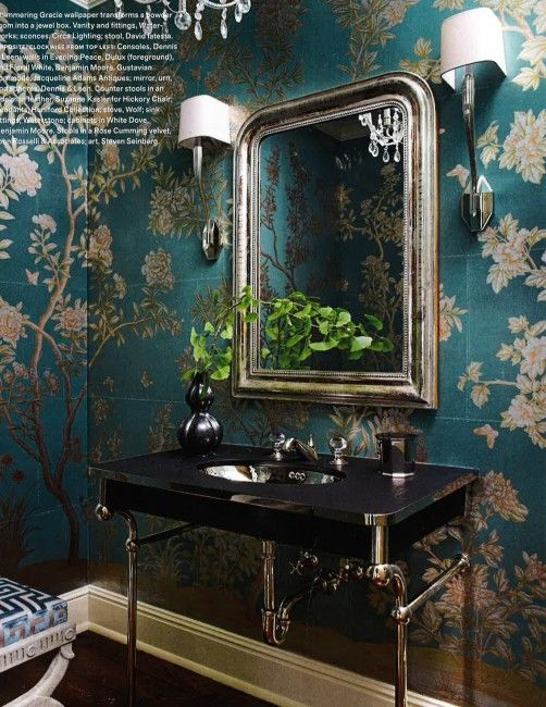 Turquoise, a great rich color, is the background for the wonderful traditional floral wallpaper. The black countertop anchors the room and the elegant Opus fitting, with its crystal egg handles is a rare kind of simplicity. The silver leaf mirror adds just the right touch of glamour. The Perfect Bath