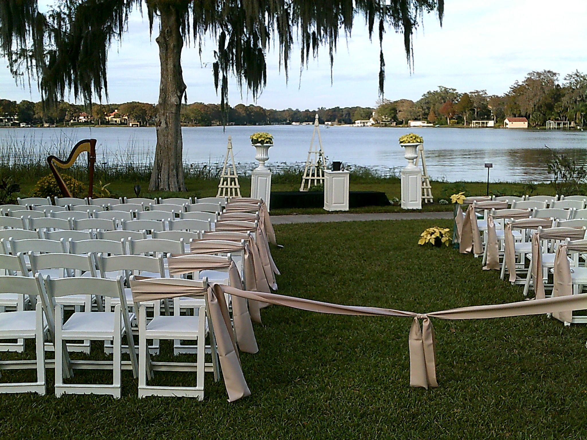 wedding ceremony on the lake in the main garden area at albin