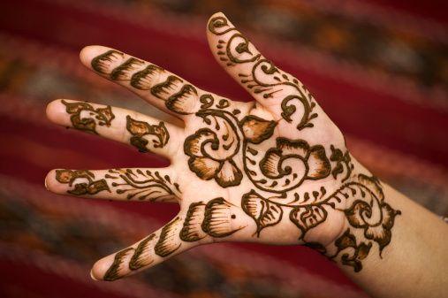 Mehndi Henna Lemon : Hand with henna decorations. powder is mixed lemon juice