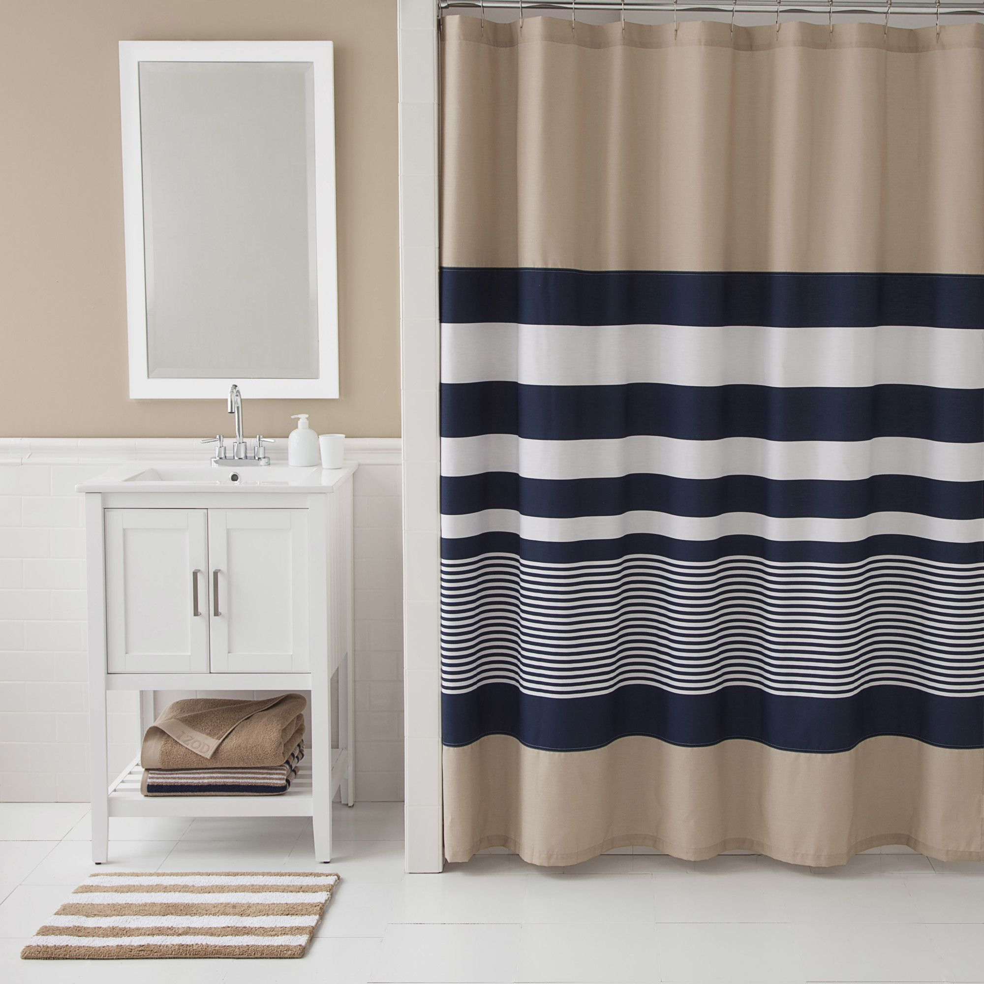 1de5d4d0e58 Add contemporary color blocking to your bath with IZOD s Classic Stripe  Shower Curtain. The bold cotton-blend curtain features navy and white  contrasting ...