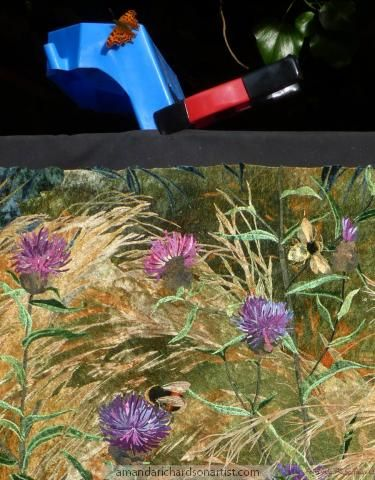 Photographing my collage of Knapweed and bumble bees life met art with a Comma butterfly joining the action.