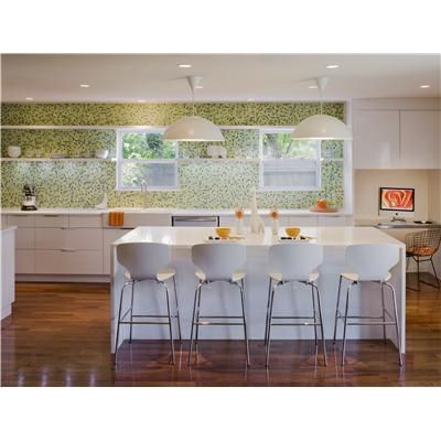 love the white with the green backsplash in this kitchen