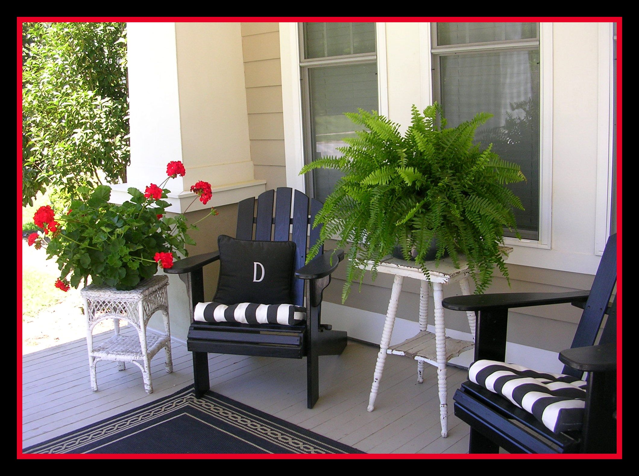 Southern porch complete with red geraniums and ferns...oh, and a big glass of sweet tea. #smallporchdecorating