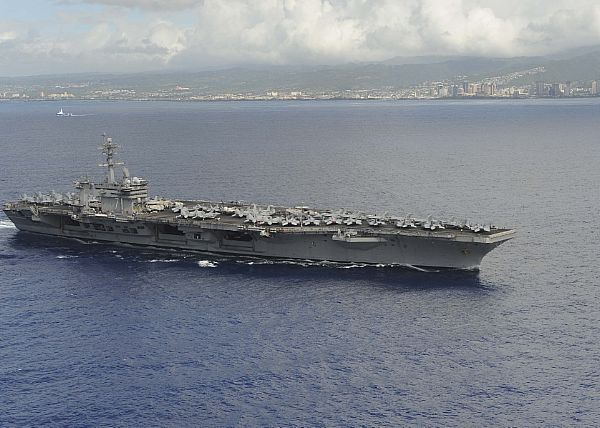 The aircraft carrier USS Theodore Roosevelt (CVN 71) departs from