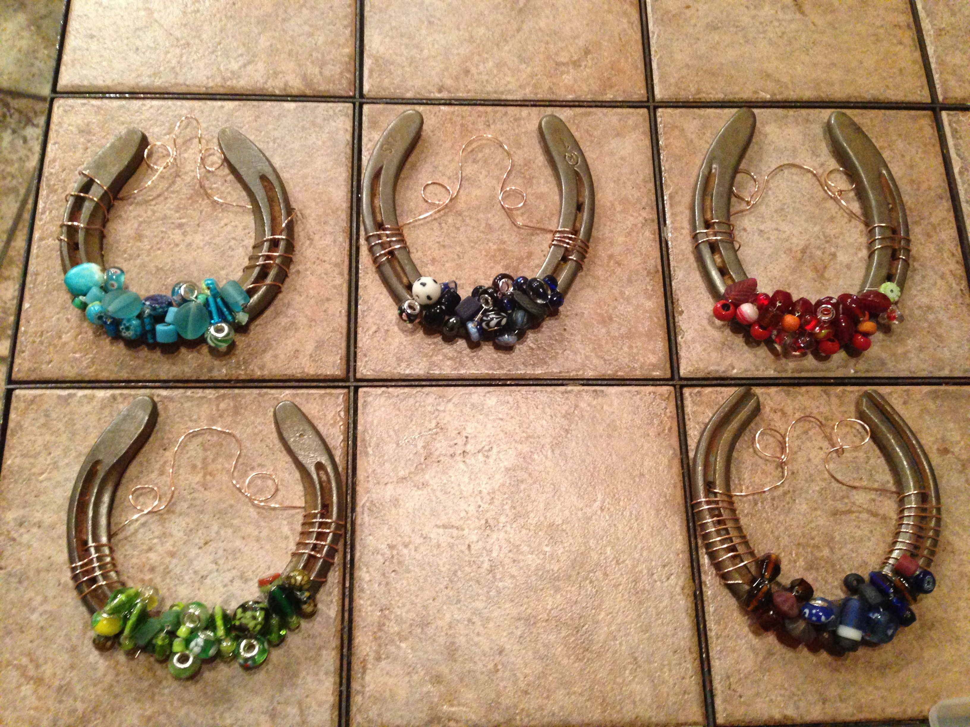 old horseshoes decorated with glass beads and copper wire
