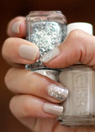 neutral nails with sporadic sparkles add the perfect