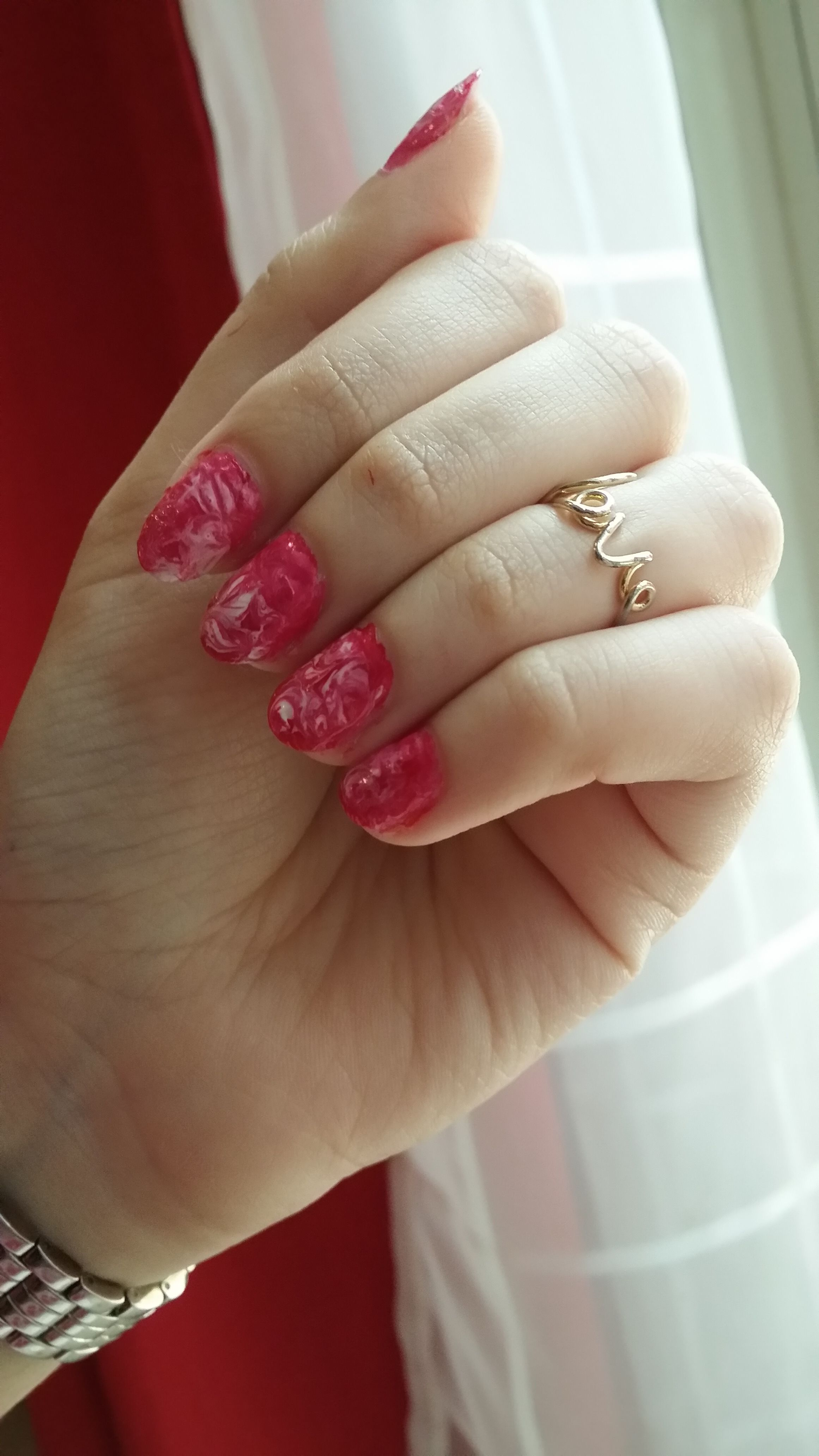 All you need is a pink and white nail colour and a toothpick to create this marble effect.