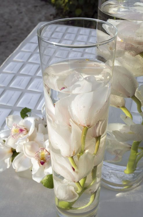 Try submerging your flowers in tall clear vases for a unique take on the flower centerpiece at your #wedding table.