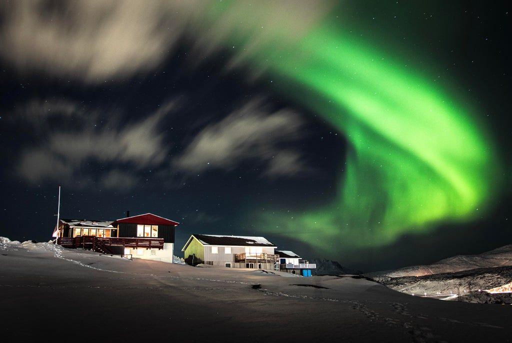 I live in Greenland Nuuk and this is my childhoodhome, the northern lights this weekend was a show! : pics