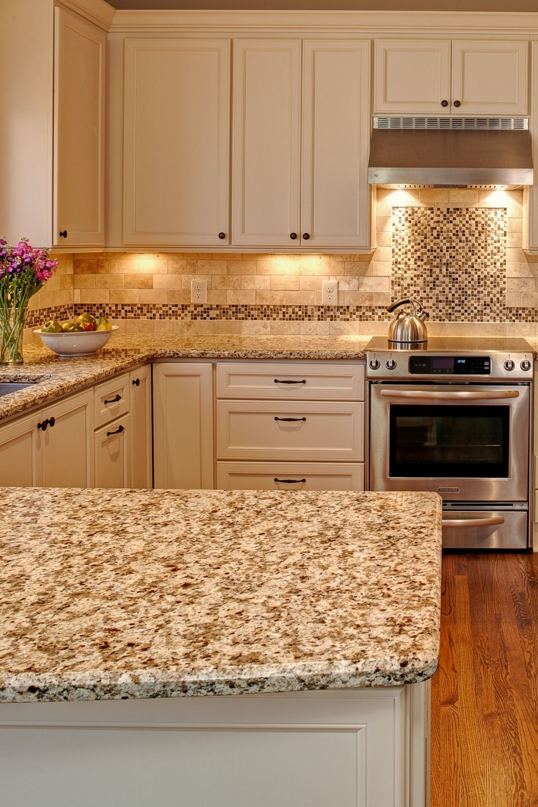 Giallo Napoli Granite Countertop White Cabinet Travertine Subway Style Backsplash Tile Dark Hardwood Floo Granite Countertops Kitchen Countertops Kitchen Decor