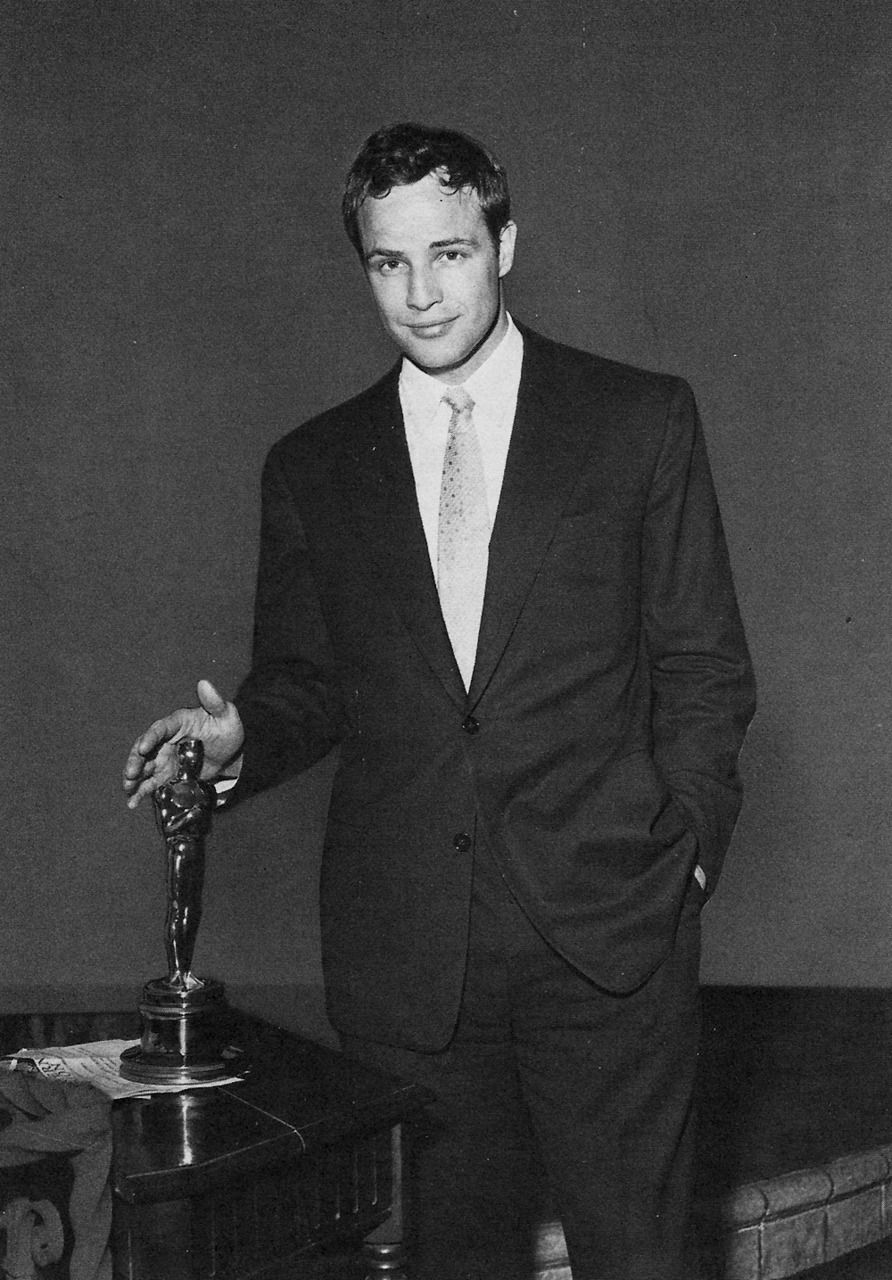 Marlon Brando with his Oscar for his performance as Terry Malloy in On The Waterfront, Dir. Elia Kazan (1954).